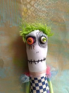 Green-haired Anxiety Faerie art doll with button eyes and embroidered and painted details.