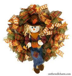 This is a lovely Fall Deco Mesh Wreath with a darling Scarecrow boy holding his pumpkin. Fall colored ribbon was added to coordinate with the little boy. It is perfect for your front door to greet you Fall Mesh Wreaths, Fall Deco Mesh, Autumn Wreaths, Holiday Wreaths, Wreath Fall, Ribbon Wreaths, Door Wreaths, Holiday Decor, Wreath Crafts