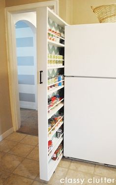 A diy rolling storage solution by Classy Clutter using the small space between the wall and refrigerator. So smart and the chevron back wall is the icing on the cake.