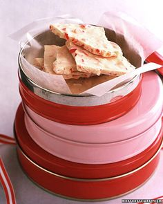 <49 of 65 >  Peppermint Bark  Simply stir peppermint oil and crushed candy canes into melted white chocolate to make this seasonal treat.  Get the Peppermint Bark Recipe