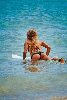 Surfer Girls,hair,buns,tanned skin,bikinis,water & a board<3 http://www.pinterest.com/Justine1515/