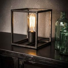 This Winston table lamp is a designed with an open square cage. The lamp is made of metal with an old silver finish. The lamp has industrial characteristics. Operable with a switch on the cord. Industrial Floor Lamps, Industrial Ceiling Lights, Industrial Table, Industrial Design, Led Röhren, Edison Lamp, How To Clean Furniture, Wood Lamps, Led Lampe