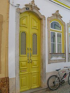 Olhão, in Algarve and its houses with bright colours, Portugal Entrance Ways, Entrance Doors, Doorway, Algarve, Cool Doors, Unique Doors, Knobs And Knockers, Door Knobs, Yellow Doors