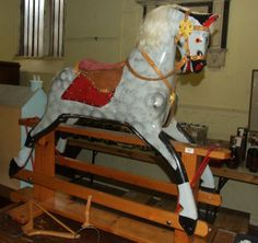 A dapple grey rocking horse, on a pine stand, 112 cm :