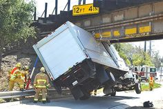 A truck carrying frozen food got stuck under a low overpass in Santa Barbara, Calif. The driver suffered injuries only to his pride, & the food went to charity