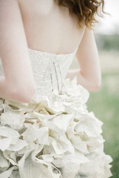 Wedding dress crafted from book pages   Bellamint Photography and Sunflower Creative   see more on: http://burnettsboards.com/2014/09/literary-wedding-book-page-wedding-dress/