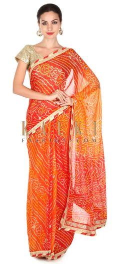 BUy this Featuring orange bandhani saree n kundan border only on Kalki