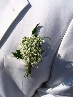 Babybreath and looped grass groom boutonniere