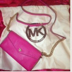 MICHAEL KORS Hot Pink Gold Chain Crossbody Purse Hot pink MK purse with gold adjustable strap... Beautiful bag! 100% authentic - used a few times, great condition, small little scuff of front barely visible... PayPal price $145...... TRADED VALUE $180 Michael Kors Bags Crossbody Bags
