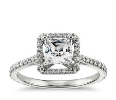 Capture the moment with this 14k white gold engagement ring, featuring a pavé-set diamond halo and your choice of center diamond.