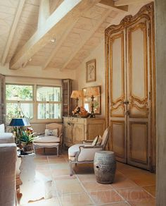 Roses and Rust: Interior Harmony - Kelly Harmon; love the way the antique armoire doors fill the height of the cathedral ceiling.