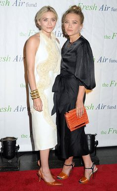 """What Were They Thinking?!  Ashely and Mary-Kate Olsen once again opted to wear unshapely garbage bags to a star-studded soiree. As Uncle Joey would say, """"Cut-it-out."""""""