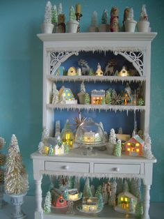 Corinne Anderson modified Little Village 1:12 and 1:24 scale glitter houses and the Snow Village glitter houses.