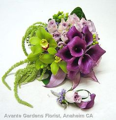 Purple callas with green orchids and lavender roses.
