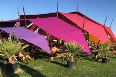 <p> Colorful structures also served as shade covers for guests on the otherwise mainly exposed festival grounds, as heat soared...