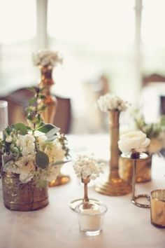 Antique brass vases and white flowers | photography by http://www.leighmillerphotography.com/