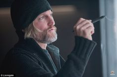 Woody Harrelson as mentor Haymitch Abernathy plotting out a course for the rebellion in District 13.