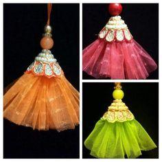 Beautiful DIY latkans / Tassels for blouse lehanga sarees Saree Tassels Designs, Saree Kuchu Designs, Handmade Rakhi Designs, Saree Blouse Patterns, Diy Tassel, Designs For Dresses, Fabric Jewelry, Fabric Flowers, Sari