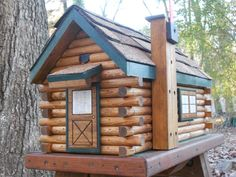 Log Cabin Mailbox, handcrafted, shingles, door and windows by CarvedByHeart on Etsy https://www.etsy.com/listing/171528921/log-cabin-mailbox-handcrafted-shingles