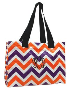 Chevron Orange and Purple Large Tote with Free Embroidery  Measures 18 W x 13 H x 7 D  Our Large Tote will quickly become your go-to-bag! Use it for groceries {holds 50lbs}, beach accessories {water resistant} or potlucks {wipes clean}. When youre done, simply fold and store it away. The Large Tote is made of laminated polypropylene. Extra wide nylon straps fit comfortably over the shoulder. This item looks great when personalized with embroidery.  Font Shown in Picture: Master Circle (used…