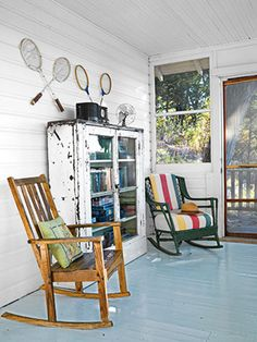 © Bob Coscarelli | Country Living Magazine - I love the idea of keeping board games and such out in the screened in porch.  And what a great use for my small pie safe.