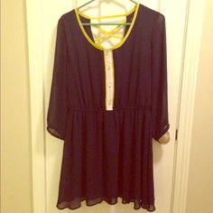 Navy Blue Dress size XL Dress size XL.  Gathered at the waist. Gold button accents on chest and sleeves. Sheer Yellow and white trim. Very cute. Some on the back is cut out. Preowned, only worn one or two times. Dresses