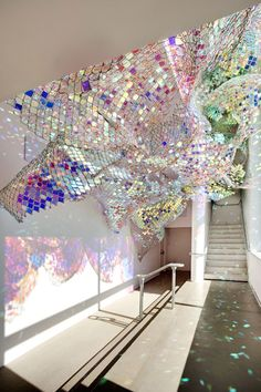 """""""Capturing Resonance"""" by Soo Sunny Park and Spencer Topel. This """"sculptural soundscape"""" is made of chain link fencing and colored Plexiglas. Motion sensors respond to visitors' movements with whispering chords, tonal washes and instrumental sounds."""