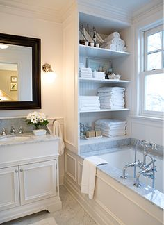 These shelves at the top of the tub give you so much extra storage. If you wanted to keep it more discreet, you could put your stuff in nice leather boxes or tight weave baskets.
