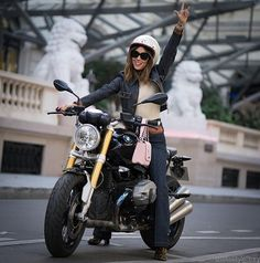 SOMEONE looks absolutely ready to get her motorcycle license.  Throwback to the #ParisFashionWeek with @SongOfStyle on my #RnineT from @BMWMotorrad_France  #BadassBiker #BMWFashionRide #YouCanRideWithUs