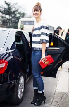 Caroline de Maigret waers a striped top, cuffed jeans, black boots, and a red Chanel bag