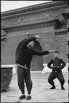 Henri Cartier-Bresson CHINA. Beijing. December 1948 Tai Chi Chuan in the Tai-miao Gardens.