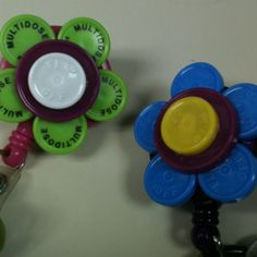"""flower power"",i upcycled these vial caps to put a little pizzazz to our ID badge. #mycreations"