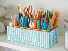 A simple stationery holder using a box with divided categories - could use PVC pipe or paper-towel rolls. A great way to easily find what you need!