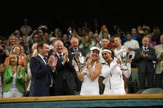 2015 Wimbledon Championships Martina Hingis and Sania Mirza with their ladies doubles trophies