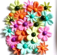 1960s flower clip earrings.  Photographed by Gillian Horsup