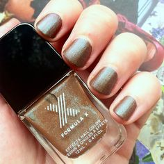One of my newer weird acquisitions: the matte Formula X polish in Determined. Brown with teal shimmer. Unfortunately without top coat it chipped within about 10 hours. And it absolutely requires a basecoat or it will stain your nails a horrible yellow. Still, it's fun and was on sale for $5.  #nails #nailpolish #manicure #mattenails #formulax #nailsofinstgram #instanails #bblogger #bbloggers #beautyblogger #beautybloggers