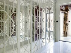 Mayfair Bachelor Pad Entrance Hallway - feature mirror panelling