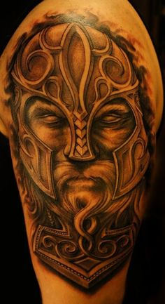 Eyeless Viking warrior in helmet tattoo on shoulder