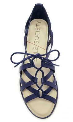 Gladiator-inspired leather lace-up sandal in dark blue