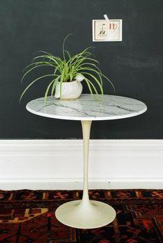 """Yesterday I showed you the """"before"""" condition of this poor little table, which was used outside by its previous owner and left to rot and weather. Today I'm showing you how to paint faux marble to use as a replacement table top for any project you have in the works. This is a very easy technique that takes hardly any time or money to do."""