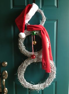 My snowman door wreath - inspiration from another pinner Melissa Ratliff.  Thanks for the idea Melissa!