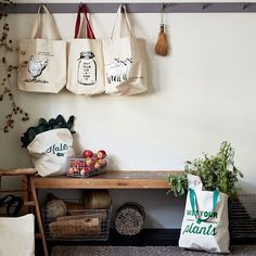 "Market Tote Bags | west elm | L-R: ""Ain't No Thing But a Chicken Wing,"" ""Shut Your Lid and Can It,"" ""Totes Ma Goats,"" (!!!) ""Oh Kale Yeah,"" and ""Wet Your Plants"""