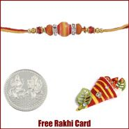 Orange Crystal Rakhi to Canada  with Free Silver Coin