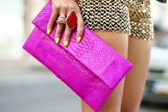 purple snake print clutch yellow nails red gemstone ring