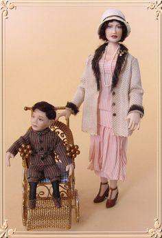 Christine and her little boy. Porcelain miniature dolls by Annemarie Kwikkel