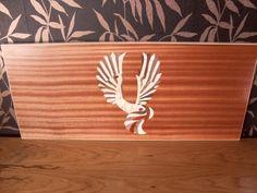 Mahogany board with inlay.