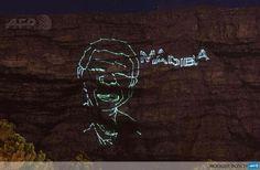 Amazing laser light installation of Mandela lights up Table Mountain.   https://www.facebook.com/photo.php?fbid=565042963571472&set=a.530987610310341.1073741829.489388954470207&type=1&theater