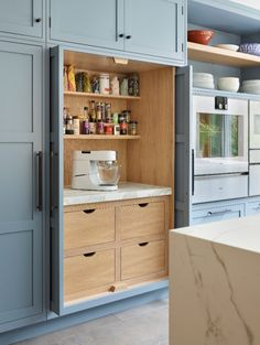 A hidden kitchen cupboard with additional workspace included.