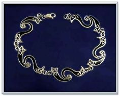 """Celtic Fire Bracelet - Jet black enamel accentuates the graceful sweeps and curls in every link of this sterling silver bracelet. Measures 7 1/2"""" overall."""