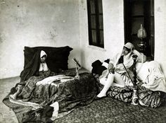 Two ladies and a child reposing in the harem, photo by Antoin Sevruguin. Late 19C